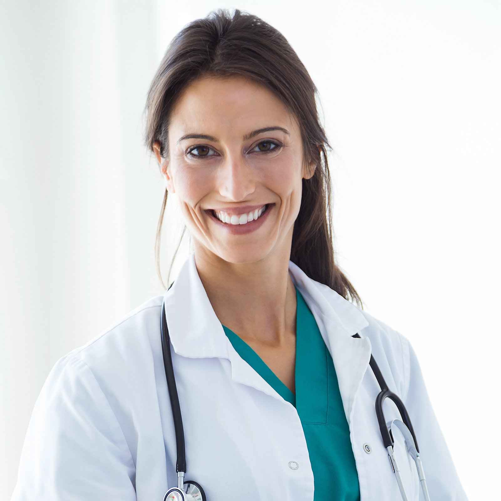 Beautiful young female doctor looking at camera in the office.